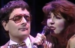 Rowan Atkinson and Kate Bush performing 'Do Bears...'